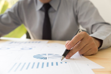 Businessman analyzing charts and graphs