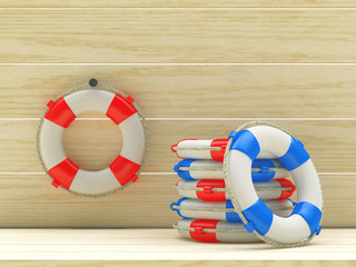 Red and blue lifebuoys on wooden background. 3d illustration