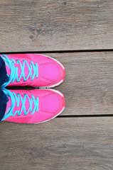 Pink Sport Shoe On Wood Slat Floor