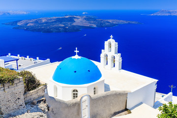 Fototapete - Santorini, Greece. Blue dome Church St. Spirou in Firostefani village.