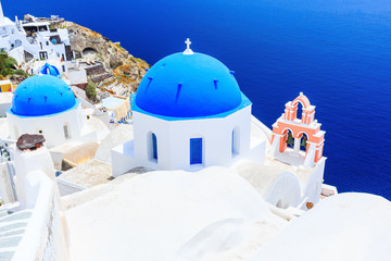 Fototapete - Santorini, Greece. Blue dome churches of Oia (Ia) village.