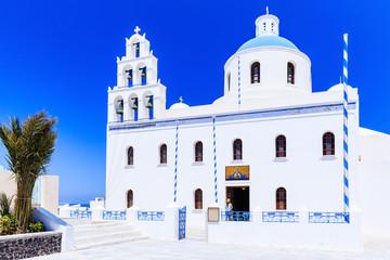 Fototapete - Santorini, Greece. Blue dome church on the village of Oia.