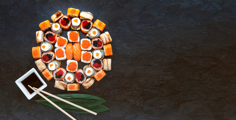 Sushi net on a black surface. Flat lay
