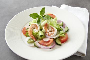 Salad of vegetables and boiled shrimp