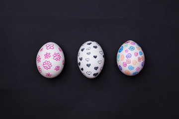 Easter eggs painted on black.
