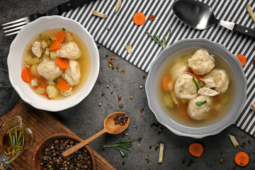 Bowls with delicious chicken and dumplings on kitchen table