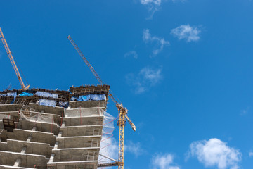 Cranes at a skyscraper construction.