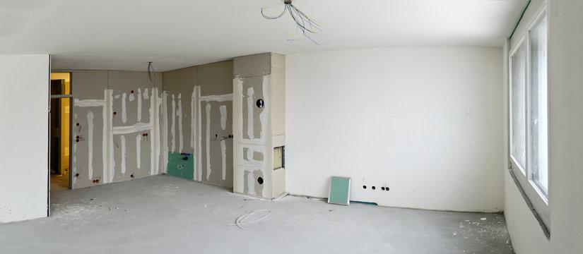 living room with kitchen corner under construction