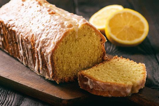 Homemade lemon bread on wooden background.