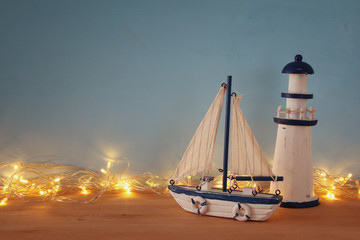 Nautical concept with sea life style objects and gold garland lights