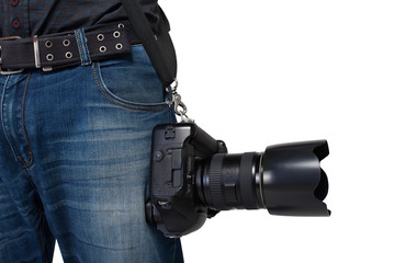 Male photographer legs with belt holding a camera