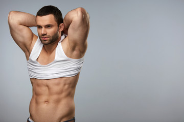 Handsome Athletic Man With Sexy Muscular Body Taking Off Clothes