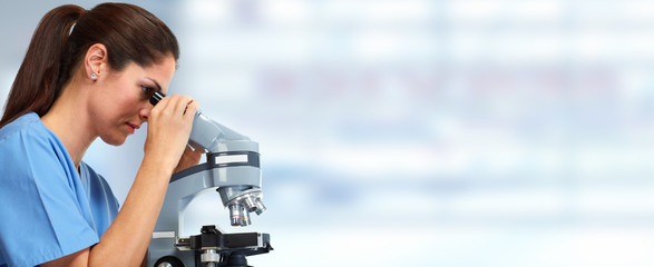 Medical doctor with microscope