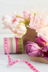 Fresh pink tulip flowers in gift kraft box