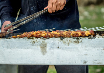 Shish kebab meat on skewers on the grill