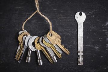 Old keys on a dark wooden background.