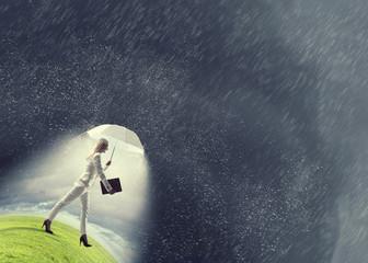 Businesswoman with white umbrella