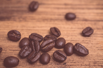 Roasted coffee beans on wood texture background