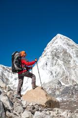 Trekker approaching PumoRi mountain in Khumbu valley on a way to Everest Base camp