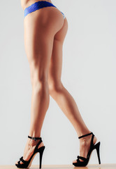 Sexy female buttocks and legs in high heel shoes
