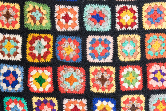 Background of colorful knitted squares flat layout