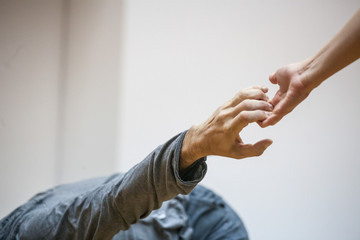 two hand dance.The hands of the dancers are drawn to each other.dancers' hands support each other