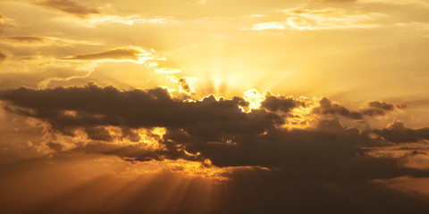 Bright sun with beams and the dark clouds