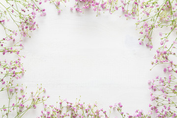 White wooden table with pink flowers, welcome spring concept