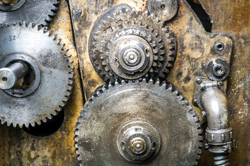 Old rusty gears of the yellow machine
