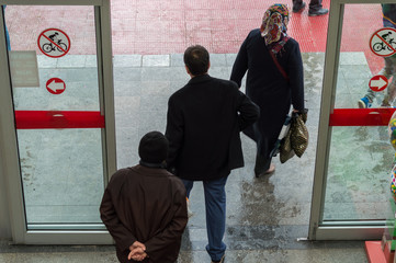 People passing by the automatic door