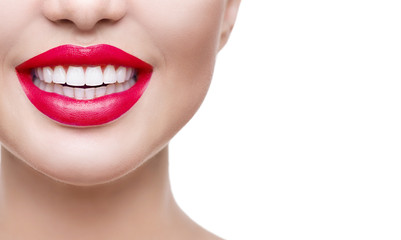 Healthy smile, teeth whitening. Beautiful model girl with red lips isolated on white background
