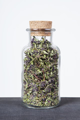Dried thyme herb inside a glass jar. Herbs and plants for tea.