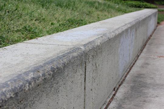 Waxed concrete bench corner for skateboarding