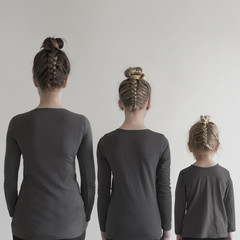 Mother and daughters with matching plait hairstyles