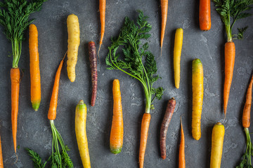 Carrots. Fresh colorful carrots on dark background. Flat lay, top view, copy space