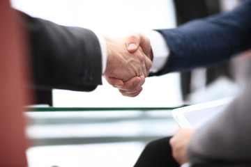 Close up view of business partnership handshake concept.Photo of two businessman handshaking process.