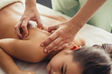 funny little girl with a massage