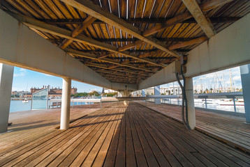 View of the marina Port Vell from under the pedestrian walkway concourse that connects the entertainment & shopping centre to the city waterfront.
