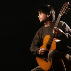 Photo sur Aluminium Musique Acoustic guitar player Guitarist playing classical guitar