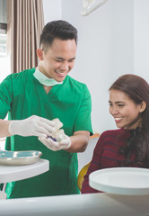dentist showing dental jaw model
