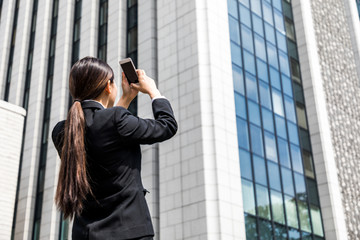 business woman taking a photo with smart phone