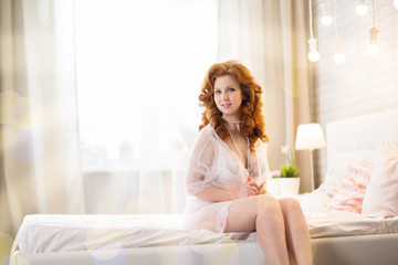 Beautiful  woman  lies on a bed