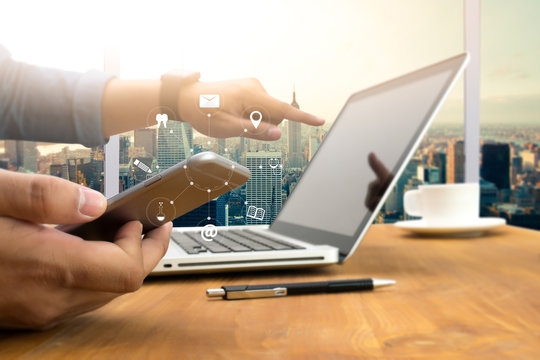 man hand holding smartphone device and  technology , businessman working with modern devices, digital tablet computer and mobile phone.