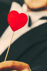 Man with heart stick love symbol in hand