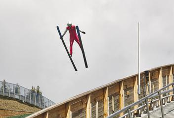 Ski jump. Artificial track. Sport background. Norwegian summer.