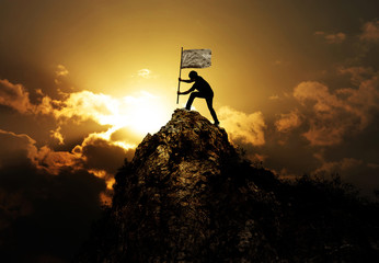 Man holding flag on the peak of mountain and sunset outdoor on nature , success winner business concept Wall mural