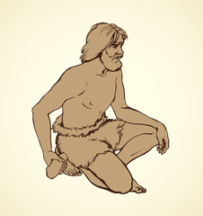 Vector picture. Primitive man draws on stone wall of cave