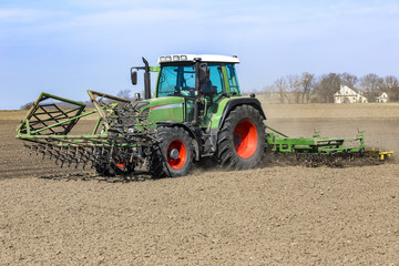 Farmer prepares the field for sowing in springtime.