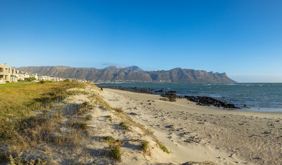 Beach scene, view east towards Gordons Bay and Hottentots-Holland Mountains. False Bay. Western Cape. South Africa.