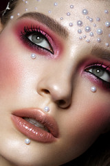Beautiful girl with perfect art makeup and pearl beads. beauty face. Photos shot in the studio.